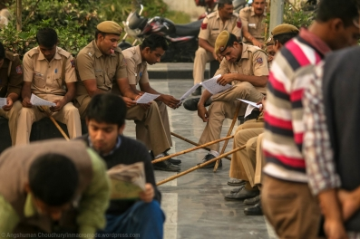 Police personnel read the agenda pamphlet distributed by the protest organisers.