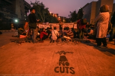 As the sun falls on the protest site, the twilight of critical conversations emerges. The beginning of a public meeting.