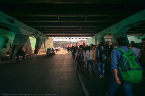 Marchers pass below a railway flyover on their way to the MHRD. What lay at the end of the tunnel was still a mystery for most participants.