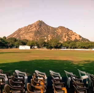 A smaller peak in the Aravalli Range towers over the main school grounds | As seen from the Bikaner Pavilion.